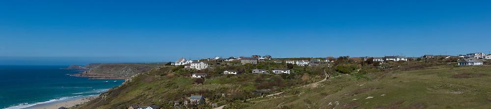 cornish coastline showing houses and sea
