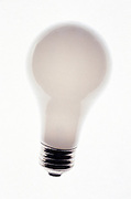 One white light bulb on a white background