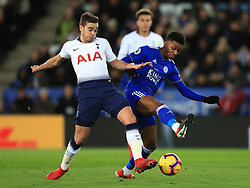 Tottenham Hotspur's Harry Winks (left) and Leicester City's Demarai Gray battle for the ball