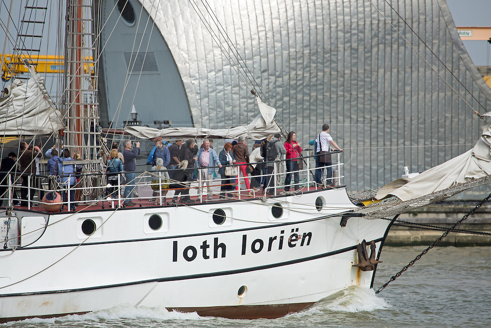 © Licensed to London News Pictures. 07/09/2014. Passengers on Loth Lorien as she goes through the Thames barrier. The biggest tall ships event in London for 25 years is continuing across this weekend. Visitors took the opportunity to sail in tall ships up and down the Thames and go onboard those moored at Greenwich and Woolwich. The Royal Greenwich Tall Ships Festival concludes on Tuesday when all 50 vessels will sail down river together. Credit : Rob Powell/LNP