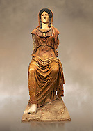 Roman statue of Athena (Roman Minerva) Sitting - from the Augustan period circa 63-43 BC the statue is a copy of a  5th century BC Greek  original, found in a palace on the Via Marmorato off the piazza dell'Emporio, Rome. The statue represents the goddess Minerva, dressed in chiton and himation which covers her head. The face and neck, now lost, have been substituted by a plaster cast of the Athena Carpegna. The aegis with the gorge emblem on her breast have enabled the goddess to be identified as Athena, the Roman Minerva, genially depicted in the guise of a helmeted female warrior. Its remarkable size suggests that this was a cult image, although a hypothesis remains linking it to the temple of Minerva on the Aventine. The sculpture bears the hallmark of a second of the 5th century BC Hellenistic Greek statue  made by Phidias. but uses different materials from the original which would have been in gold and ivory .National Roman Museum, Rome, Italy <br /> <br /> If you prefer to buy from our ALAMY PHOTO LIBRARY  Collection visit : https://www.alamy.com/portfolio/paul-williams-funkystock/roman-museum-rome-sculpture.html<br /> <br /> Visit our ROMAN ART & HISTORIC SITES PHOTO COLLECTIONS for more photos to download or buy as wall art prints https://funkystock.photoshelter.com/gallery-collection/The-Romans-Art-Artefacts-Antiquities-Historic-Sites-Pictures-Images/C0000r2uLJJo9_s0