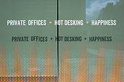 As it is reported that a further 428 people have died with Covid-19 in the UK, the total number of deaths in hospitals and the wider community to 33,614, the wider implications of social distancing in the workplace after lockdown is being widely discussed with the concept of hot desking being a thing of the past. A closed Hot Desking office space in Noel Street, Soho advertises in its window, on 14th May 2020, in London, England.