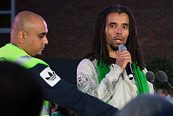 London, UK. 14 June, 2019. Rapper Akala reads out the names of members of the Grenfell community who lost their lives in the Grenfell Tower fire following the Grenfell Silent Walk on the second anniversary of the tragedy. 72 people died and over 70 were injured in the Grenfell Tower fire.