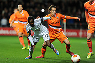 Nathan Dyer of Swansea city is challenged by Valencia's Andres Guardado. UEFA Europa league match, Swansea city v Valencia at the Liberty Stadium in Swansea on Thursday 28th November 2013. pic by Andrew Orchard, Andrew Orchard sports photography,