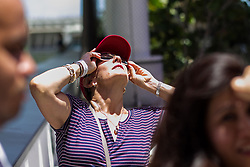 Miami-Dade County School Board Member Susie Castillo watches the solar eclipse at the Phillip and Patricia Frost Museum of Science on Monday, Aug. 21, 2017. Photo by Sebastian Ballestas/Miami Herald/TNS/ABACAPRESS.COM