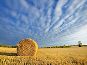 Bales and clouds<br /> South Baptiste<br /> Alberta<br /> Canada