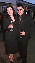 Australian singer TINA ARENA and MR RALF CARR, at a reception in London on 6th June 1998.MIB 141