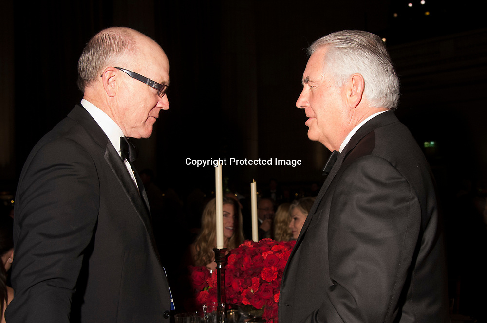 Treasury Secretary nominee Woody Johnson (L) and Secretary of State nominee Rex Tillerson (R) speak during the Chairman's Global Dinner at the Andrew W. Mellon Auditorium in Washington DC on January 17, 2017.