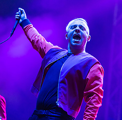 © Licensed to London News Pictures. 29/08/2015. Reading Festival, UK.  Everything Everything performing at Reading Festival 2015, Day 2.  In this picture - Jonathan Higgs.  Photo credit: Richard Isaac/LNP