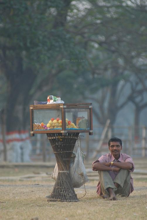 A hawker on the maiden near victoria memorial, Kolkata, January 2007