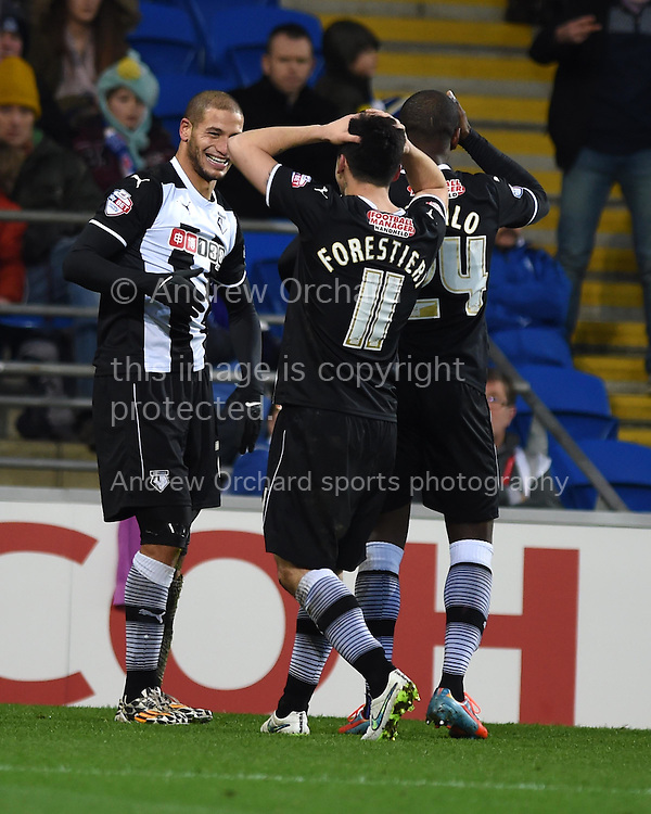 Watford's Adlene Guedioura (l) celebrates after he scores his teams 3rd  goal to make it 1-3.  Skybet football league championship match, Cardiff city v Watford at the Cardiff city stadium in Cardiff, South Wales on Sunday 28th December 2014<br /> pic by Andrew Orchard, Andrew Orchard sports photography.