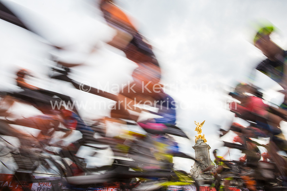 London, UK. 3 August, 2019. Riders from sixteen of the world's top professional female cycling teams pass in front of Buckingham Palace during the Prudential RideLondon Classique. The Classique, which is the richest one-day women's race in the world, covers 20 laps of a tight circuit of 3.4 kilometres around St James's Park and Constitution Hill.