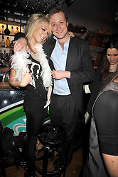 SOPHIE CROSS and EDWARD NICHOLSON at a party for Glenmorangie hosted at Barts,  Sloane Avenue, London on 26th March 2009.