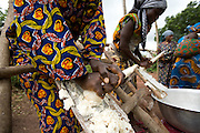 Women grind cassava to make gari - a local staple - in the village of Alandohou, Benin on Monday September 10, 2007. The women are part of a unicef-sponsored micro-credit programme that helps them make income to send their children to school.