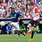NLD/Rotterdam/20100919 - Voetbalwedstrijd Feyenoord - Ajax 2010, Vurnon Anita  in duel met Fedor Smolov