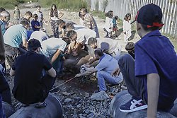 September 1, 2017 - Istanbul, Turkey - September 1, 2017 - Istanbul, Turkey - People try to tie down a bull before having its throat slit during the Eid al-Adha celebrations in Istanbul on September 1, 2017. Muslims across the world are preparing to celebrate the annual holiday of Eid al-Adha, or the Festival of Sacrifice, by visiting the tombs of their loved ones and slaughtering sheep, goats, cows and camels, marking the end of the Hajj pilgrimage to Mecca and in commemoration of Prophet Abraham's readiness to sacrifice his son, Ismail, on God's command. (Credit Image: © Can Erok/Depo Photos via ZUMA Wire)