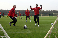 Photo: Paul Thomas.<br /> Manchester United training session. UEFA Champions League. 16/10/2006.<br /> <br /> Darren Fletcher (L) and Wayne Rooney.