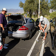 Golden State Golf Tour players Dustin Gibbs, right, and Brian Miller prepare for the day's round in the parking lot. There are no locker facilities like on the PGA Tour.