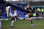Carlisle United's Brad Potts sees his shot blocked by Tranmere Rovers' Ian Goodison. Skybet football league 1 match, Tranmere Rovers v Carlisle United at Prenton Park in Birkenhead, England on Saturday 29th March 2014.<br /> pic by Chris Stading, Andrew Orchard sports photography.