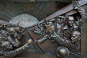 As the UK government urged that all Britons should avoid non-essential travel abroad in order to combat the Coronavirus pandemic in Britain and when physical contact is discouraged, a detail showing families saying farewell to departing WW1 troops at a station platform, found on the lower base of the statue entitled The Meeting Place by British artist Paul Day, on 17th March 2020, in London, England. The Meeting Place is a 9-metre high, 20-tonne bronze statue that stands at the south end of the upper level of St Pancras evoking the romance of travel through the depiction of a couple locked in an amorous embrace. Its cost is reported to be £1 million. St. Pancras is the London terminus for Eurostar services to mainland Europe.