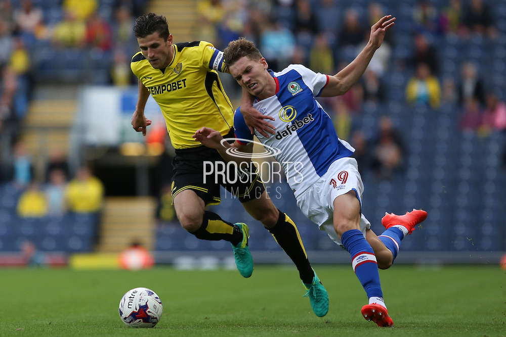 Sam Gallagher of Blackburn Rovers is fouled by John Mousinho of Burton Albion during the EFL Sky Bet Championship match between Blackburn Rovers and Burton Albion at Ewood Park, Blackburn, England on 20 August 2016. Photo by Simon Brady.
