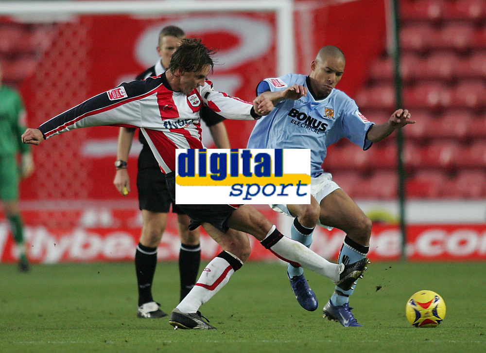 Photo: Lee Earle.<br /> Southampton v Hull City. Coca Cola Championship. 04/11/2006. Hull's Jason Jarrett (R) battles with Claus Lundekvam.
