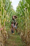Kids run thru a corn maze in Greene County, Va.