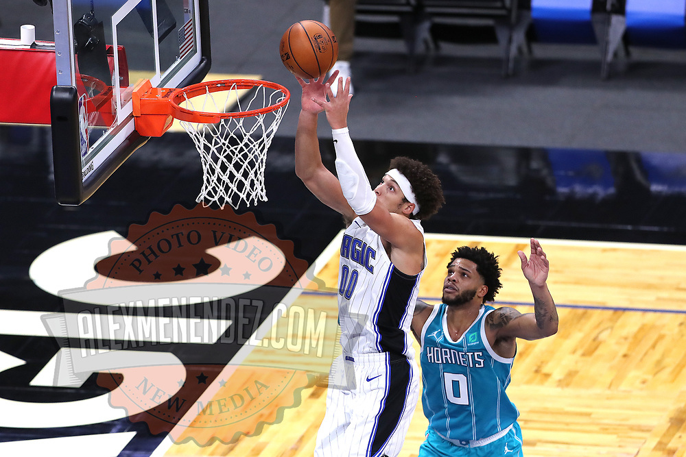 ORLANDO, FL - DECEMBER 17:  Aaron Gordon #00 of the Orlando Magic shoots as Miles Bridges #0 of the Charlotte Hornets looks on at Amway Center on December 17, 2020 in Orlando, Florida. NOTE TO USER: User expressly acknowledges and agrees that, by downloading and or using this photograph, User is consenting to the terms and conditions of the Getty Images License Agreement. (Photo by Alex Menendez/Getty Images)