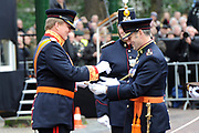 In Den Haag, op Plein 1813 vindt een vaandelgroet plaats van de Koninklijke Landmacht aan Koning Willem-Alexander. De vaandelgroet is tevens de aftrap van het 200-jarig jubileum van de Koninklijke Landmacht. <br /> <br /> In The Hague, on Plein 1813 a banner greeting takes place from the Royal Army of King Willem-Alexander. The standard greeting is also the kickoff of the 200th anniversary of the Royal Army.<br /> <br /> Op de foto / On the Photo:  Koning Willem-Alexander krijgt van luitenant-generaal Mart de Kruif een sabel aangeboden<br /> <br /> King Willem-Alexander gets from Lieutenant General Mart de Kruif a saber offered