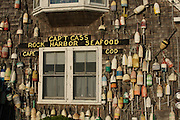 Old buoys decorate the side of a building, Rock Harbor, Orleans (Cape Cod), Massachusetts.