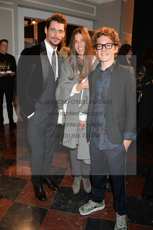 Left to right, DAVID GANDY, ELIZABETH SALTZMAN and her son HARRY WALKER at the Dolce & Gabbana London Collections: Mens Event 2014 held at Dolce & Gabbana, 53-55 New Bond Street, London on 5th January 2014.