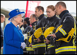 June 16, 2017 - London, United Kingdom - QUEEN ELIZABETH II meets firefighters during a visit to the Westway Sports Centre, London, which is providing temporary shelter for those who have been made homeless by the fire at Grenfell Tower.  (Credit Image: © i-Images via ZUMA Press)