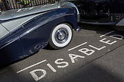 A 1964 Empress Bentley is parked in a Disabled bay in Smith Square, a small square behind the Houses of Parliament, before collecting its VIP passengers - barristers who are being sworn in as QCs (aka Silks in legal vernacular), on 11th March 2019, in London, England.