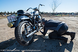 Working on a vintage Harley-Davidson Sportster in the pits at Brat Style's flat track racing at West Point Offroad Village. Kawagoe, Saitama. Japan. Wednesday December 6, 2017. Photography ©2017 Michael Lichter.
