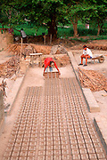 MEXICO, E.COAST, VERACRUZ STATE making handmade bricks for construction projects near Papantla