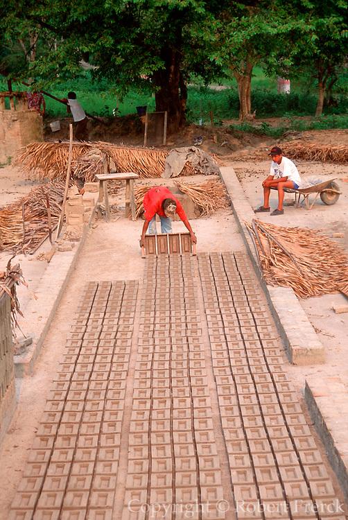MEXICO, E.COAST, VERACRUZ STATE making handmade bricks for construction projects near Papantla