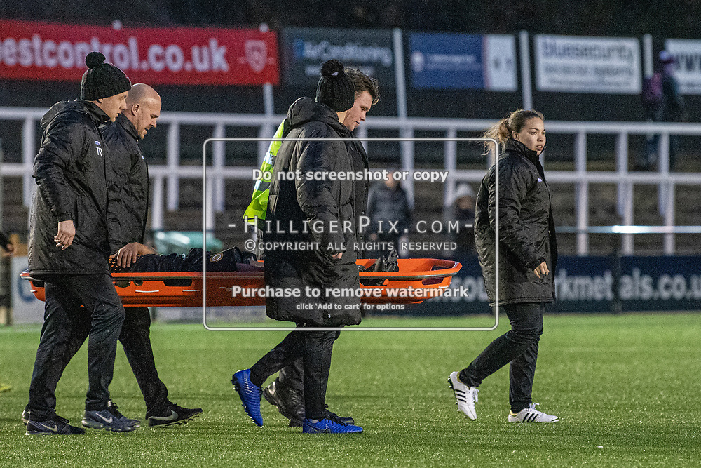 BROMLEY, UK - DECEMBER 07: Ally Maloney, Physio of Cray Wanderers FC, leads the way to the treatment room as Jerome Federico, of Cray Wanderers FC, gets stretchered off during the BetVictor Isthmian Premier League match between Cray Wanderers and Potters Bar Town at Hayes Lane on December 7, 2019 in Bromley, UK. <br /> (Photo: Jon Hilliger)