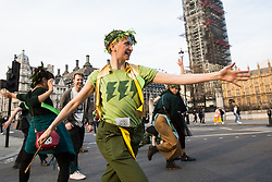 London, UK. 18th April 2019. Climate change activists from Extinction Rebellion at Parliament Square take part in the fourth day of the International Rebellion to call on the British government to take urgent action to combat climate change.