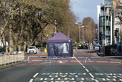 © Licensed to London News Pictures. 11/01/2017. Brighton, UK. A forensic tent covers the body of a pedestrian who was killed by a car that was being persued by police on Tuesday Evening. The vehicle in question was later found abandoned Madeira Drive. The pedestrian was pronounced dead at the scene. Photo credit: Hugo Michiels/LNP