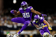 Minnesota Vikings running back Alexander Mattison (25) runs the football during an NFL wild-card playoff football game against the New Orleans Saints, Sunday, Jan. 5, 2020, in New Orleans. The Vikings defeated the Saints in overtime, 26-20. (Ryan Kang via AP)