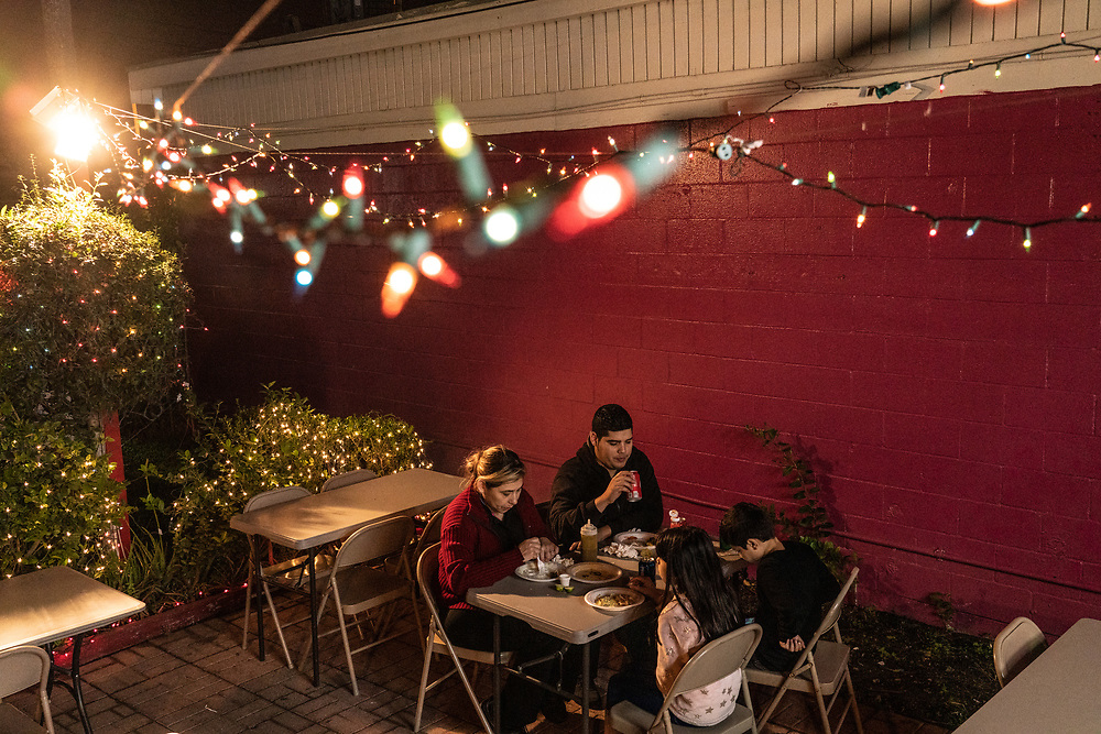 A family eats dinner at a Mexican fast food spot in Brownsville, Texas.