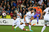 Leroy Sane of Manchester city ® watches his shot at goal blocked by Swansea's Jordi Amat and Neil Taylor (l).  EFL Cup. 3rd round match, Swansea city v Manchester city at the Liberty Stadium in Swansea, South Wales on Wednesday 21st September 2016.<br /> pic by  Andrew Orchard, Andrew Orchard sports photography.