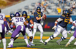 Nov 14, 2020; Morgantown, West Virginia, USA; West Virginia Mountaineers quarterback Jarret Doege (2) drops back to pass during the second quarter against the TCU Horned Frogs at Mountaineer Field at Milan Puskar Stadium. Mandatory Credit: Ben Queen-USA TODAY Sports