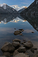 Mount Redoubt is reflected in Chilliwack Lake at sunset - Chilliwack Lake Provincial Park.