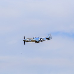 Lancaster, PA, USA - August 22, 2015: A P-51 Mustang during the fly-over at the Lancaster Airport Community Days air show.