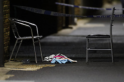 © Licensed to London News Pictures. 23/09/2020. London, UK. A blood soaked towel lies on the pavement  near St James Primary School in Bermondsey, south London after a man was shot in broad daylight earlier today. Police say at 3:24pm officers were called to St James' Primary School, SE16, following reports of gunshots heard. The victims injuries have been described by police as both life-threatening and life-changing. No arrests have been made. Photo credit: Peter Macdiarmid/LNP