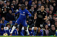 Ngolo Kante of Chelsea (L) in action with Shinji Okazaki of Leicester City (R). Premier League match, Chelsea v Leicester City at Stamford Bridge in London on Saturday 13th January 2018.<br /> pic by Steffan Bowen, Andrew Orchard sports photography.