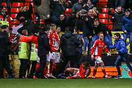 Charlton Athletic midfielder Krystian Bielik (4) on loan from Arsenal, is hurt as the fans invade the pitch during the EFL Sky Bet League 1 match between Charlton Athletic and Accrington Stanley at The Valley, London, England on 19 January 2019.