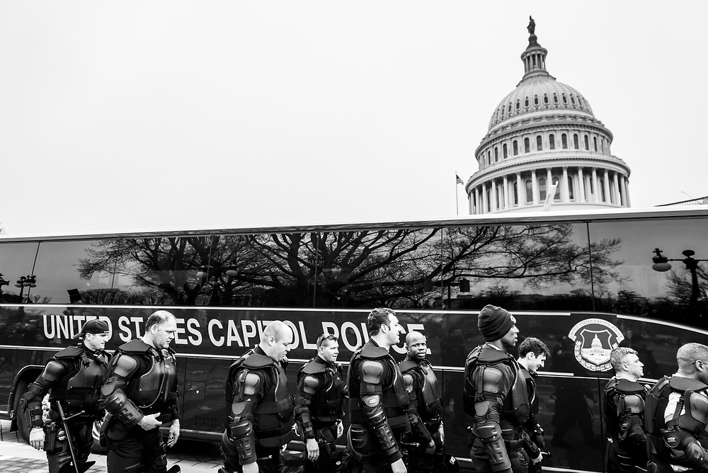 Washington DC, USA - January 21, 2017: Men and women of the United States Capitol Police force stand outside a bus on the Capitol grounds, deployed for the Women's March in Washington DC.