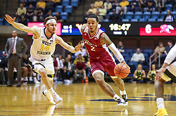 Nov 28, 2018; Morgantown, WV, USA; Rider Broncs guard Jordan Allen (2) drives past West Virginia Mountaineers guard Chase Harler (14) during the first half at WVU Coliseum. Mandatory Credit: Ben Queen-USA TODAY Sports